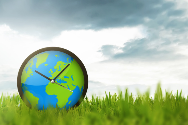 clock of globe on the meadow