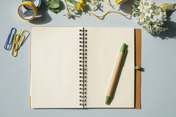 notebook office supplies and spring flowers