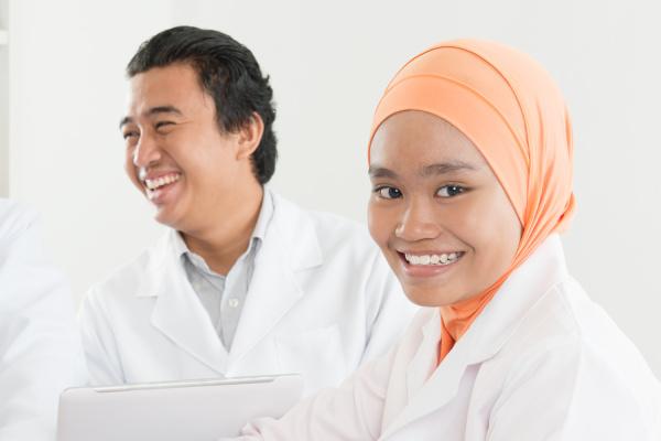 happy asian muslim nurse