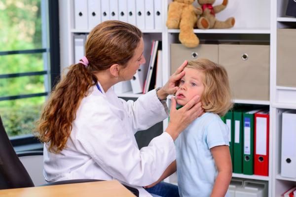 female pediatrician in white lab coat