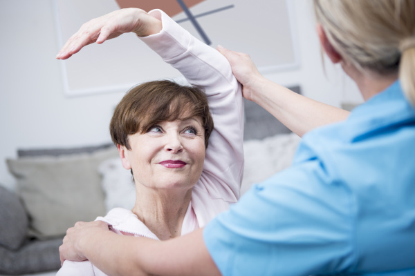 gereatric nurse doing physio therapy with