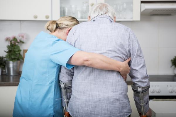 gereatric nurse supporting week patient