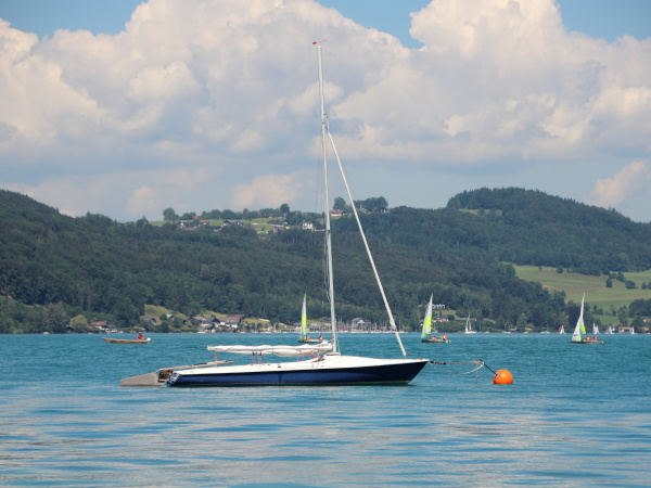 sailing ship on blue lake with