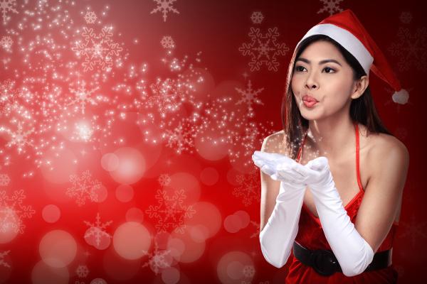 asian woman in santa claus costume