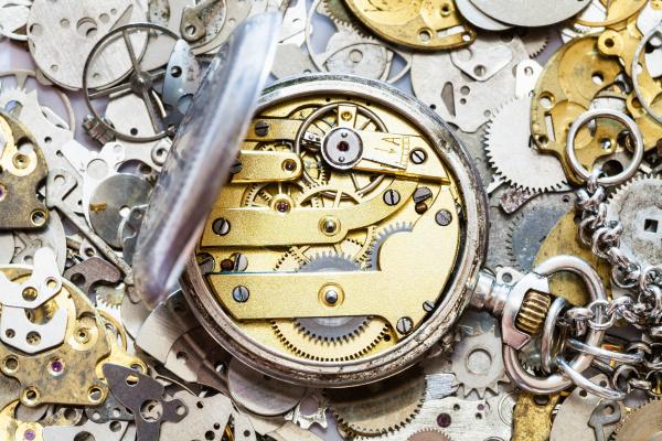 open vintage pocket watch on heap