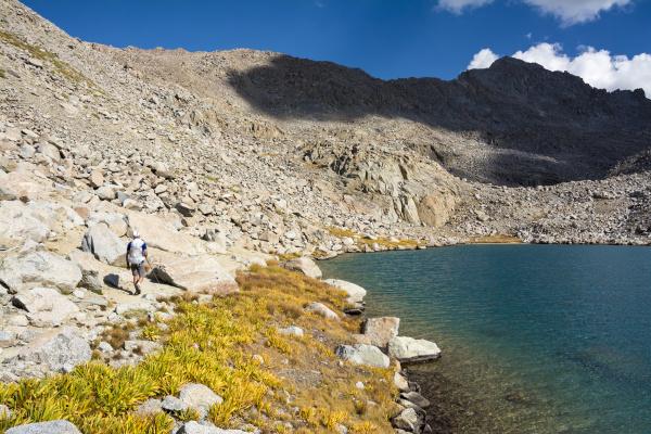 man hiking by darwin basin