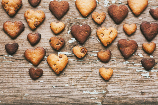 heart shape cookies on wooden table