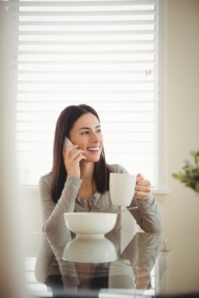 smiling woman talking on mobile phone