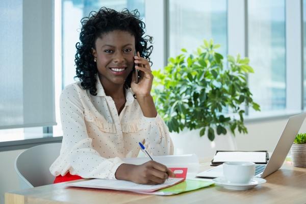 female executive talking on mobile phone