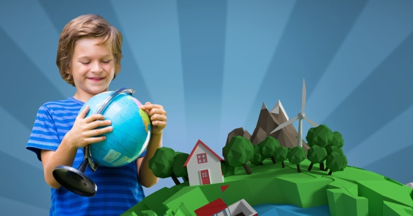 smiling boy holding globe while standing