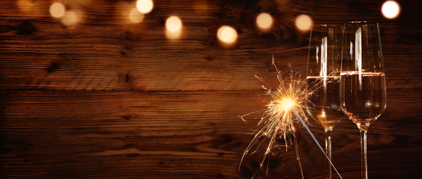 wooden wall with champagne and sparkler