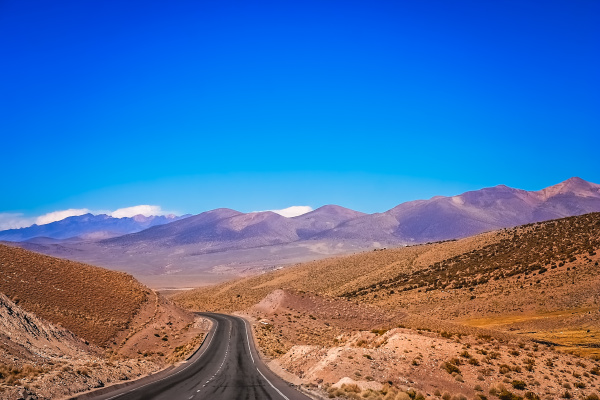 empty paved road through nevado sajama