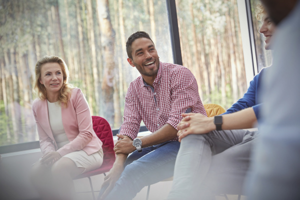smiling man listening in group therapy