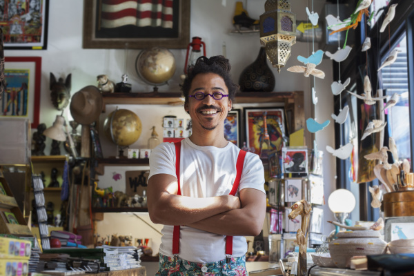 smiling mixed race man wearing suspenders