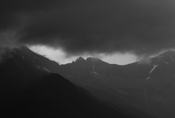 dark storm clouds over a mountain
