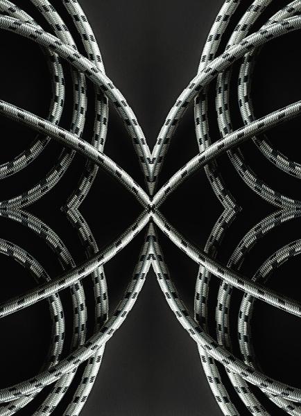 kaleidoscopic image of ropes on black