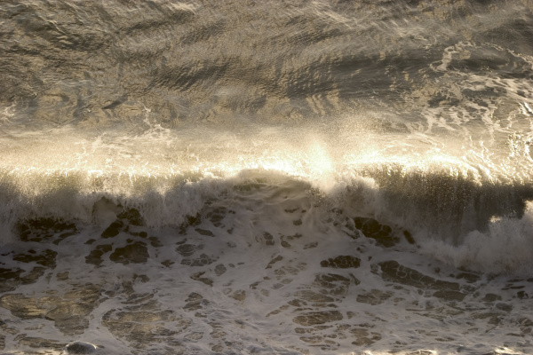 wave in the evening light