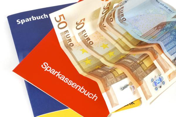 savings book and banknotes