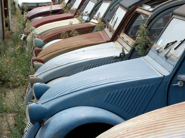 scrap yard with various generations of