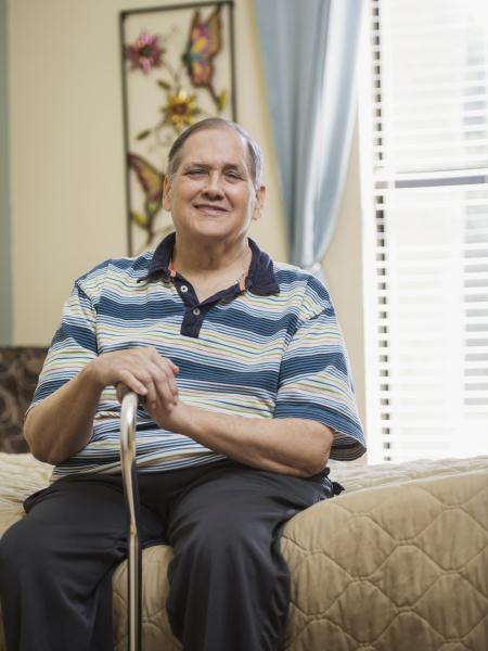 smiling caucasian man sitting on bed