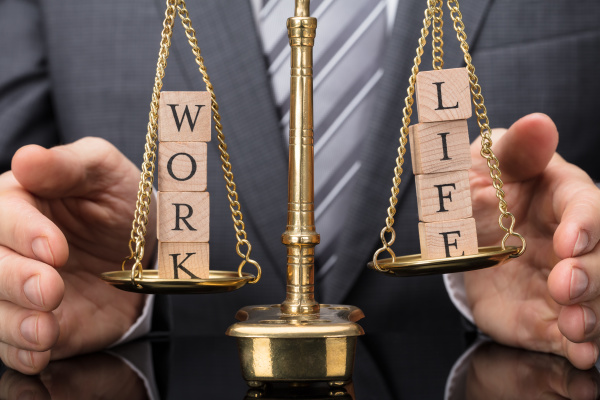 person protecting justice scale with work
