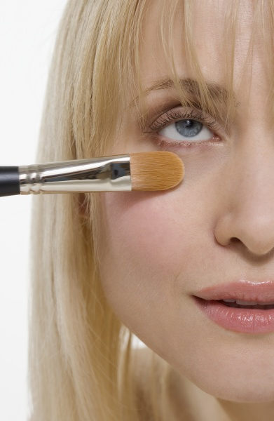 closeup of cosmetic brush on face