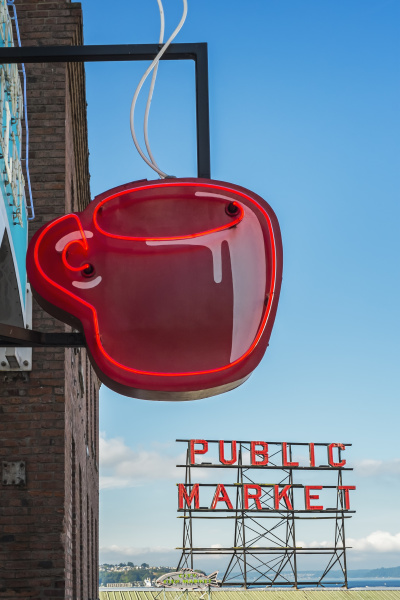 neon coffee cup in front of