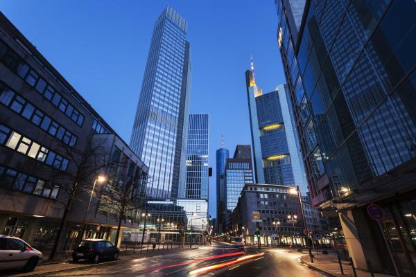 illuminated city street with skyscrapers