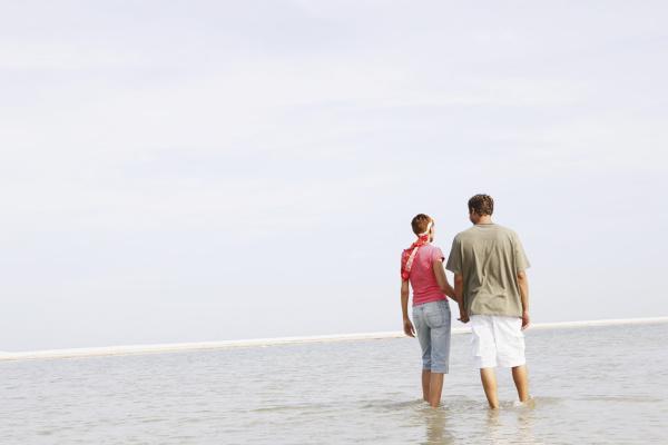 couple wading in ocean