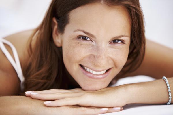 studio portrait of woman smiling