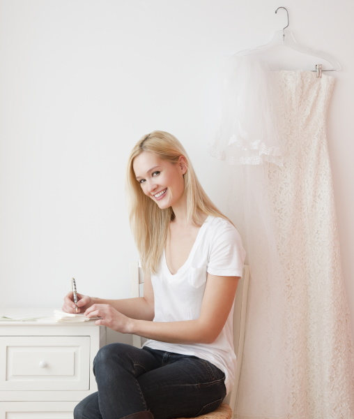 portrait of young woman writing wedding