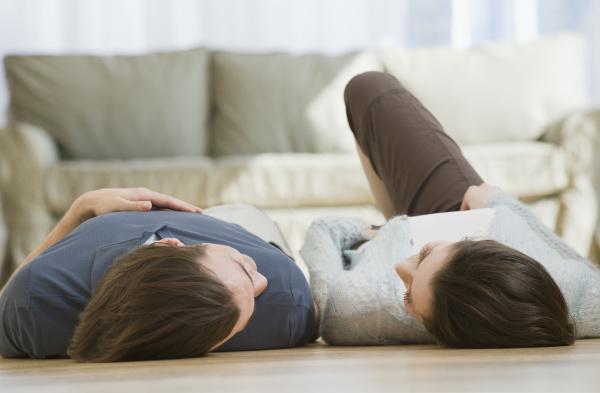 couple laying on floor
