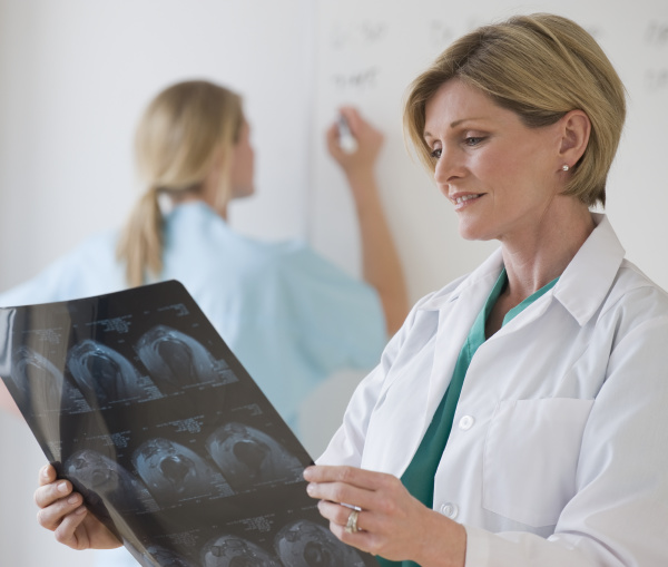 female doctor looking at x rays