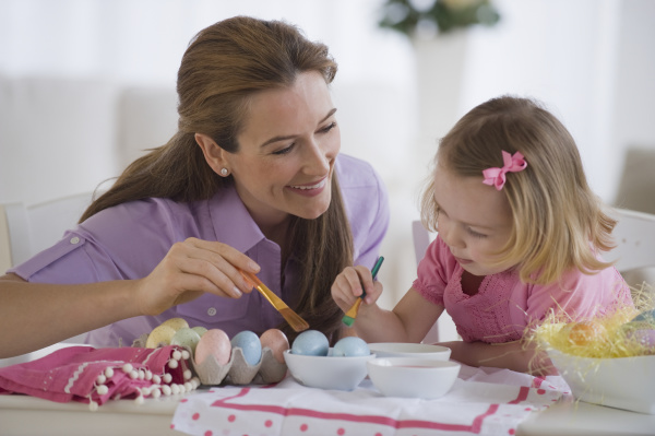 mother and daughter decorating eggs