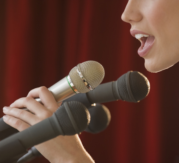 woman speaking into microphone