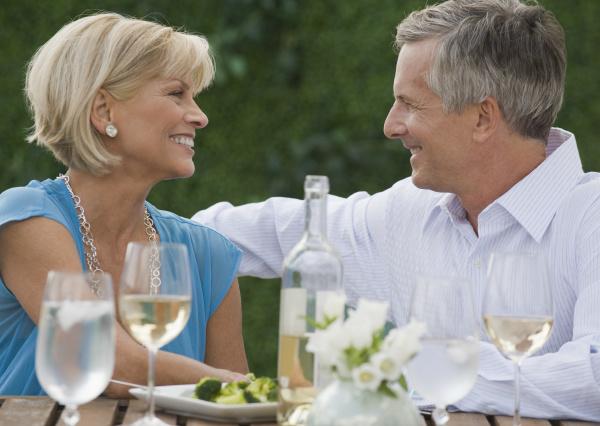 couple enjoying wine outdoors