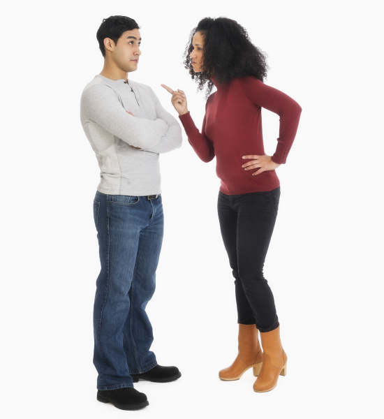 studio shot of young couple arguing