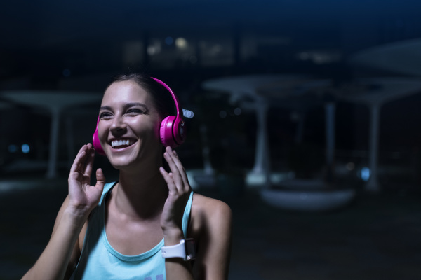 happy, young, woman, with, pink, headphones - 24167124