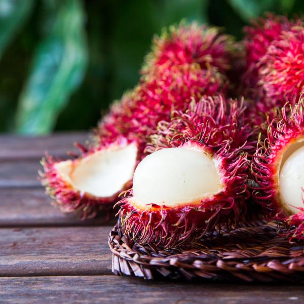 fresh ripe rambutans on wooden background