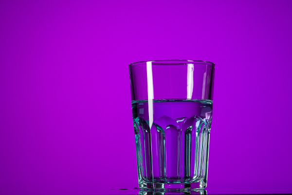 the water in glass on lilac