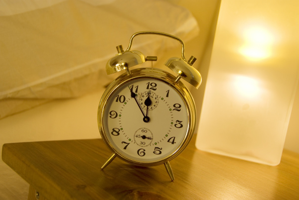 alarm clock on the bedside table