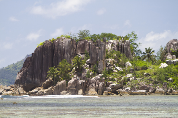 granite formations with coconut trees