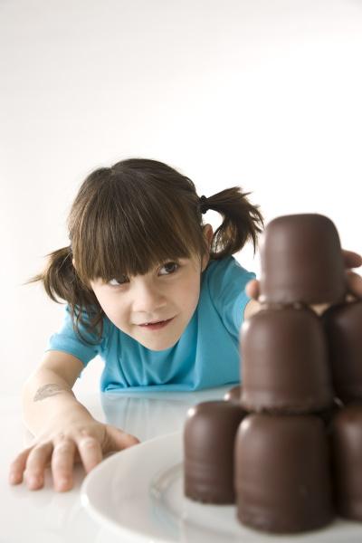 little girl steals a chocolate kiss