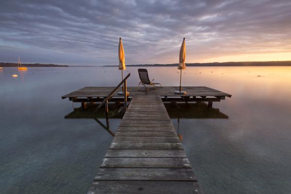 sunrise boardwalk at lake starnberg