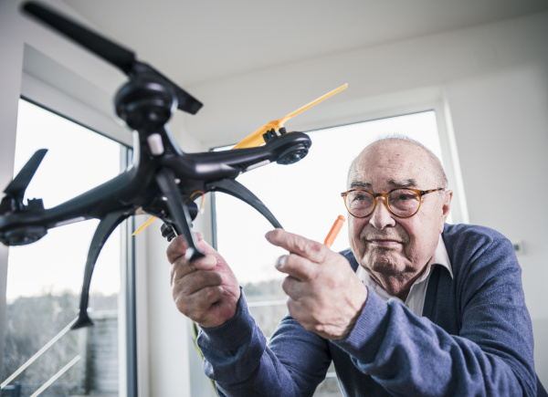 portrait of senior man holding a