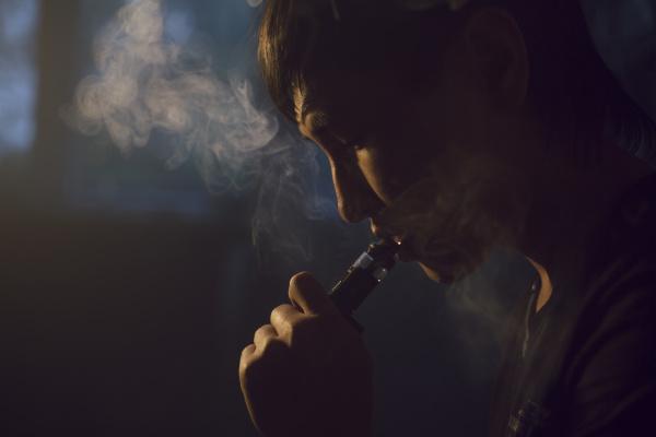 close up of man smoking hookah