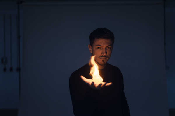 portrait of magician with flame