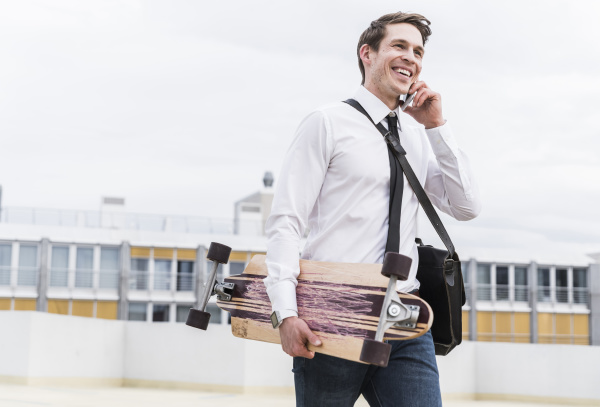 happy businessman with cell phone and