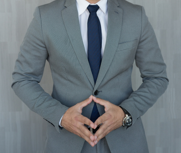 torso of anonymous businessman standing with