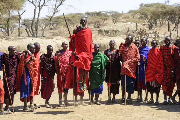 maasai warriors wearing brightly coloured clothing